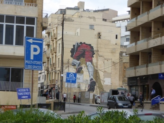 This graffiti is half of a street art achieved by the french artist MTO. The other half is painted on a building in Sapri, Italy.