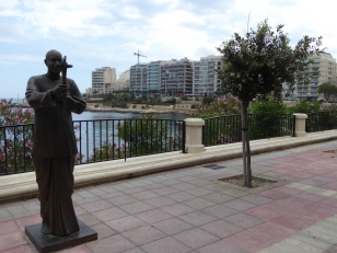 Sri Chinmoy statue on Sliema's promenade as symbol of peace. Malta